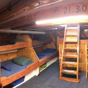 The lower deck has been fitted out with Single and Double bunks - all shared accommodation